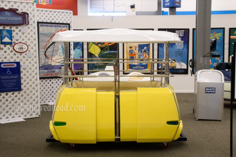 Yellow PeopleMover ride vehicle.