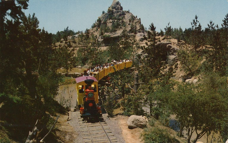The Mine Train rolls through the forests of the wild west.