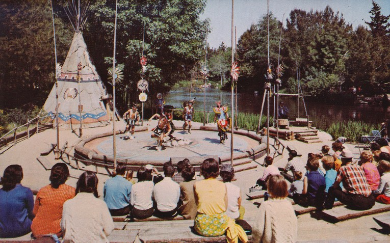 Native Americans dance in the circle, with tipis to the left, and the Rivers of America on the right.