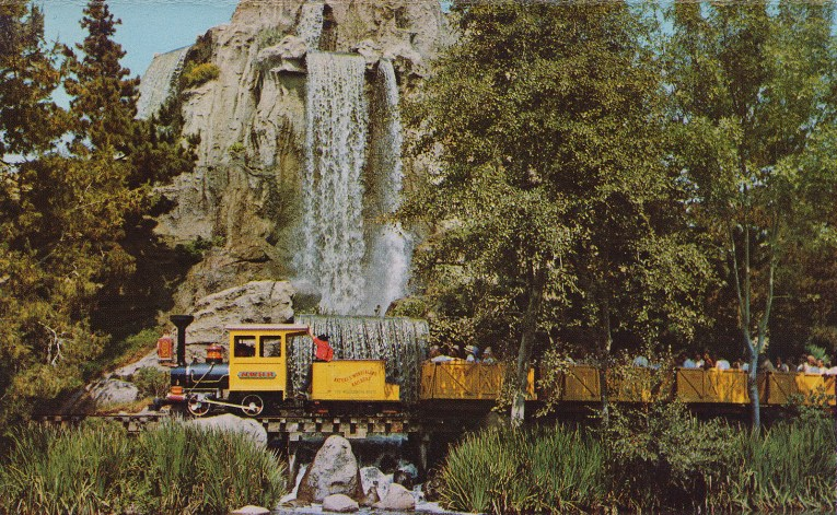 The Mine Train rides past Cascade Peek, where a waterfall just brushes against the tracks.