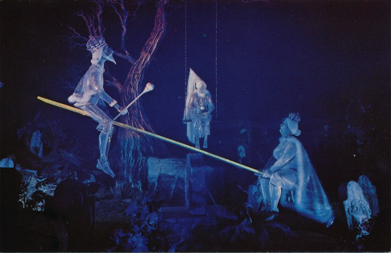 Inside the Haunted Mansion - ghosts ride a see-saw.