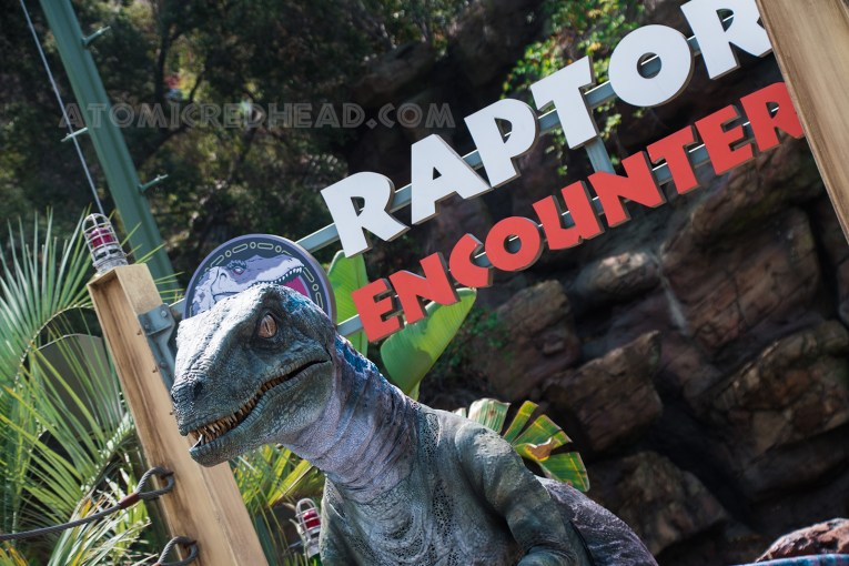 Guests may meet a fairly friendly raptor just outside the ride.