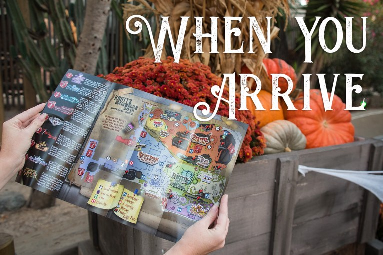 When You Arrive - Two hands holding a map for Scary Farm over a wheelbarrow of pumpkins.