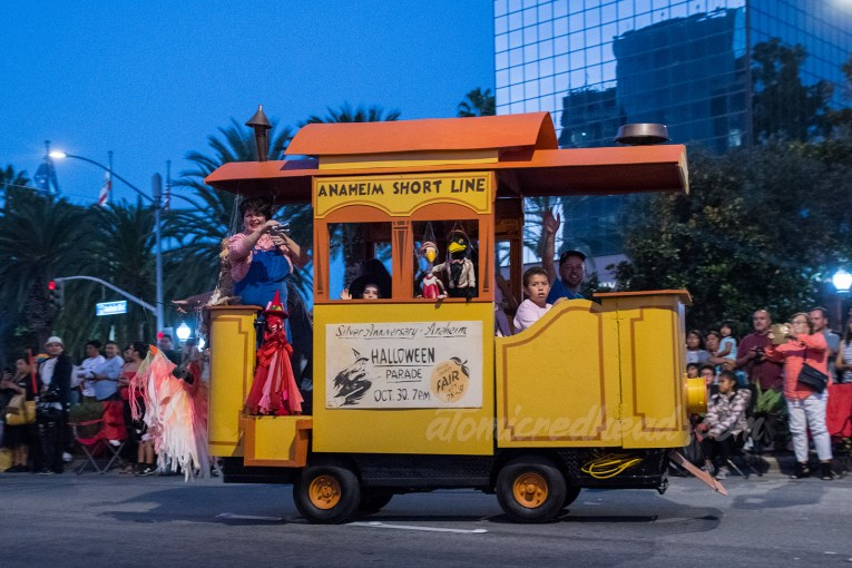 A faux old-fashioned trolley carries the Bob Baker Marionette performers with various puppets.