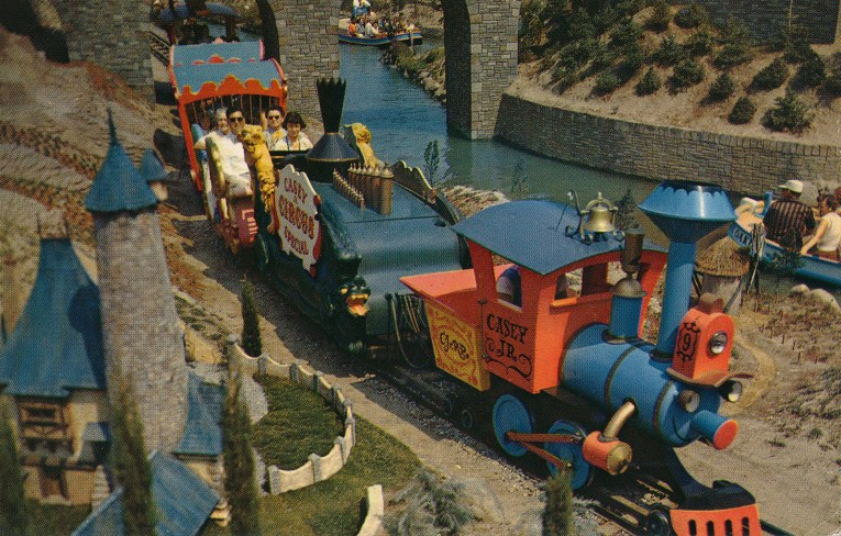 Casey Jr. train, a colorful train that chugs along a track through Storybookland.