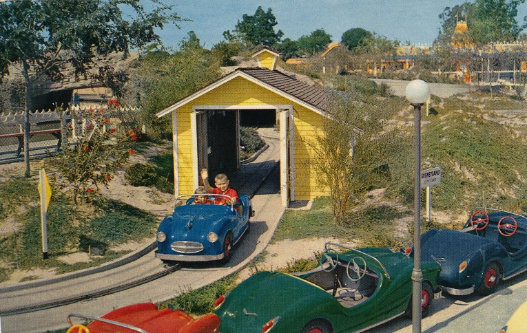 Midget Autopia, children drive small brightly colored cars.