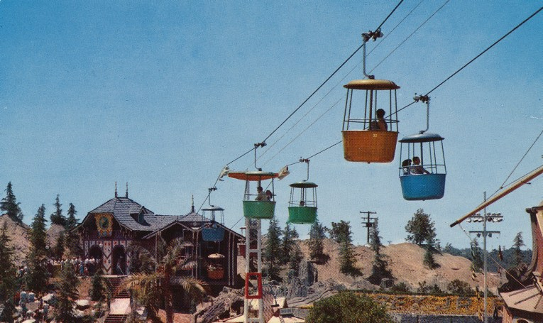 Fantasyland Skyway, a Swiss inspire chalet, Guests board round buckets that carry them over Fantasyland.