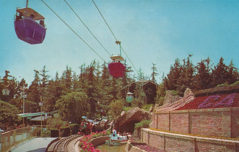 The Skyway buckets ride high above the Storybookland boats.