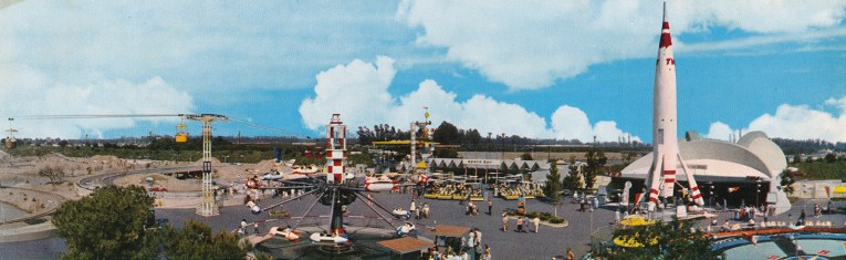 The Astro Jets spin off to the left, the Autopia in the background, the tall TWA Rocket to the Moon stands tall on the right.