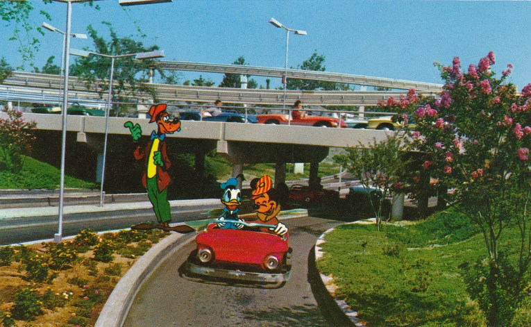 "Autopia, Guests drive small cars along the ""freeways of the future."" Here Goofy asks for a lift, while Mickey and Donald drive."