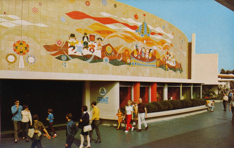 A massive mural of children from around the world above doorways to attractions.