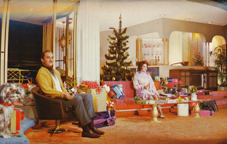 Inside the Carousel of Progress, the age of electricity, The same man as before now sits in a home of contemporary furnishings and electric lights and TV.