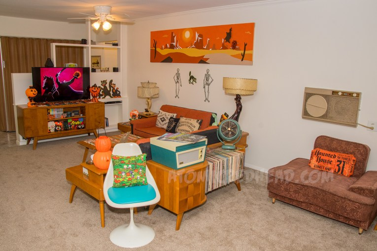 The living room in orange and black glory with witches and pumpkins.