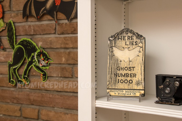 """A small tombstone reading """"Here Lies Ghost Number 1000 Disneyland's Haunted Mansion"""""""