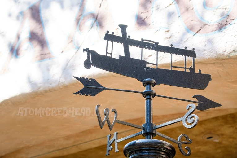 A weathervane of a Jungle Cruise boat.