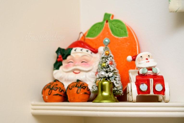 A small ceramic Santa drives a tiny car.