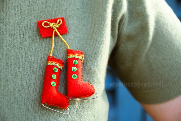 Detail of my brooch, red ice skates made of felt and sequins.