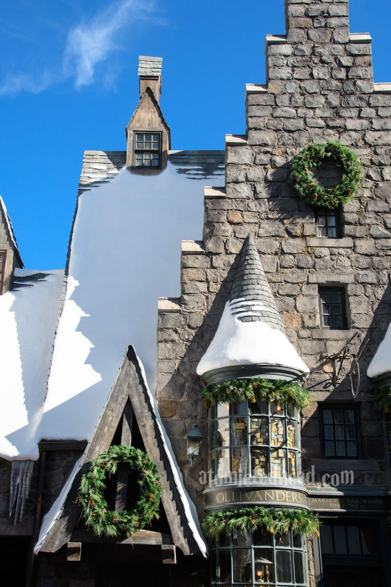 Olivander's Wands, which features a green wreath and garlands along the tops of the windows.