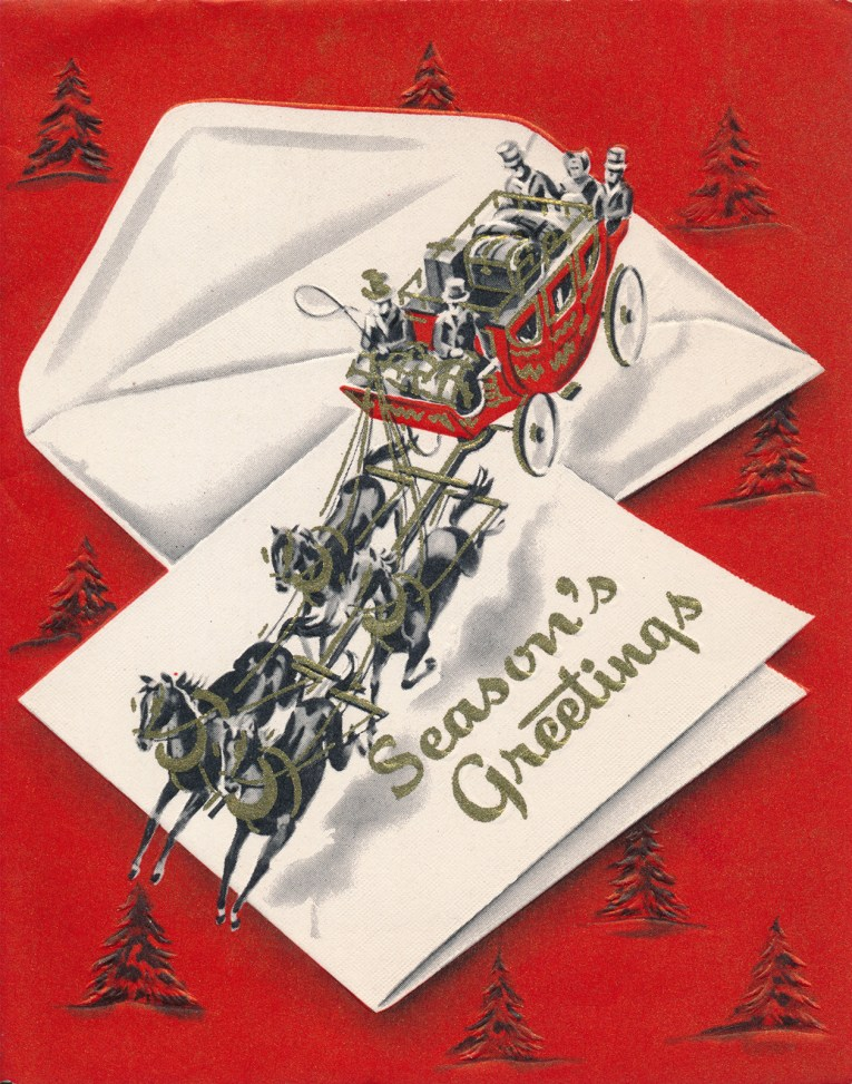 """A carriage is pulled by four horses across a large envelope and card, which reads """"Season's Greetings"""""""