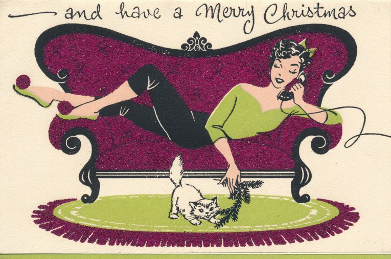 """A girl in a green shirt and black pants sits on a purple couch, she is on the phone and playing with her cat who is on the floor. Across the top it reads""""and have a Merry Christmas"""""""