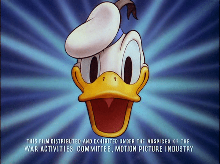 "A blue screen features Donald Duck's face in the center, a smiling cartoon duck with a sailor hat. Along the bottom it reads ""This film distributed and exhibited under the auspices of the War Activities Committee, Motion Picture Industry."""