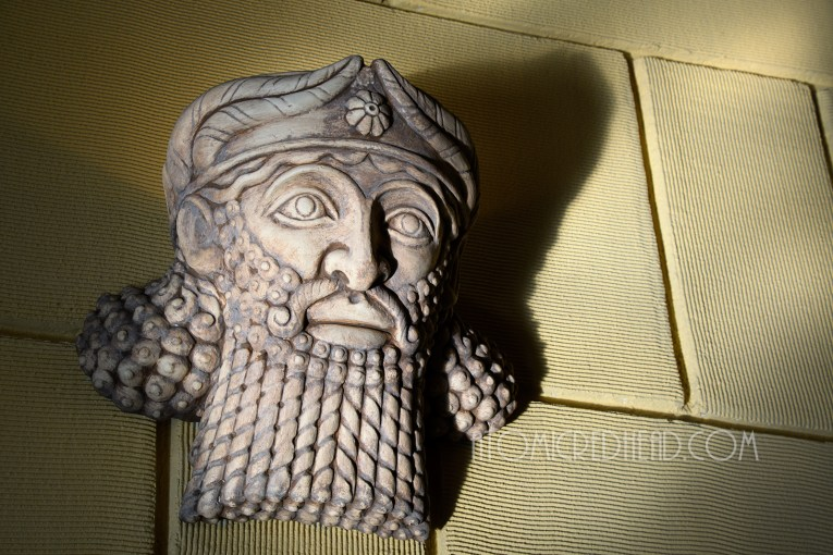 Assyrian male faces are wall sconces, they have long twisted bears and long curly hair and small short crowns.