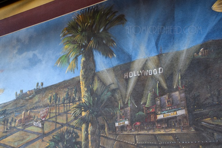 "A mural features the Chinese Theater, which reads ""Ben-Hur"" on the marquee."