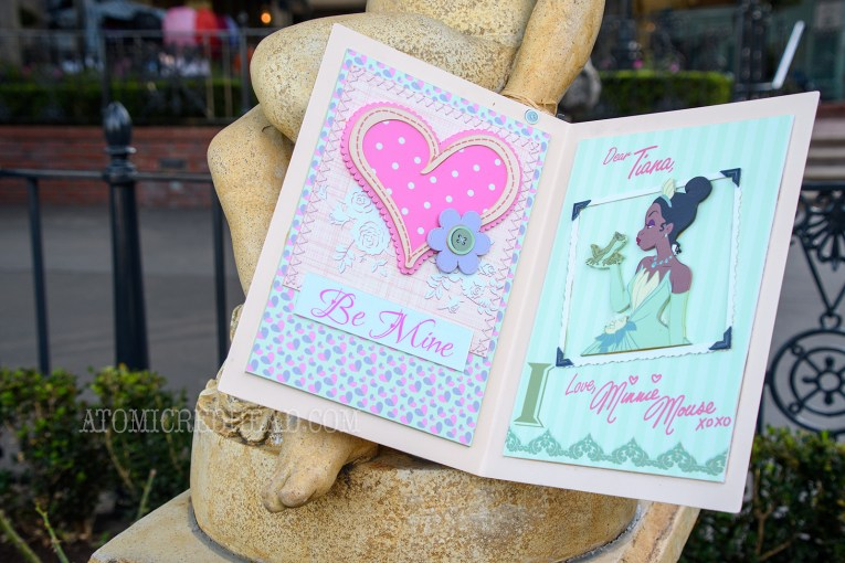 A valentine for Tiana sits near a statue in New Orleans Square.