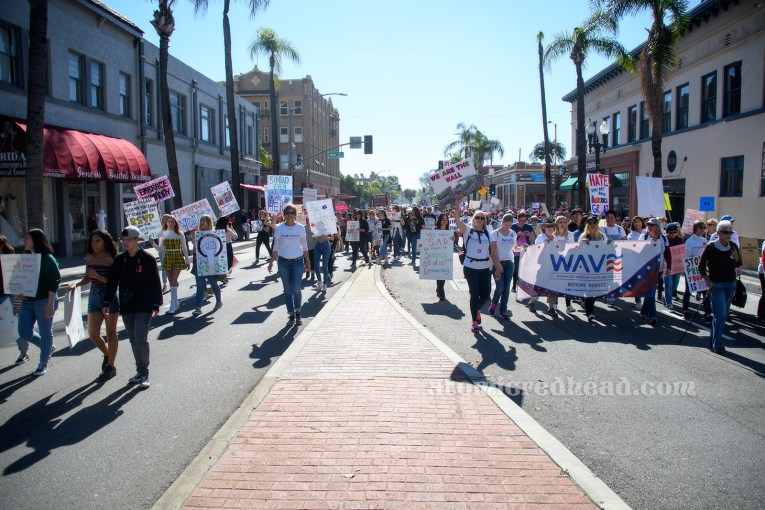 Marchers walk through downtown Santa Ana.