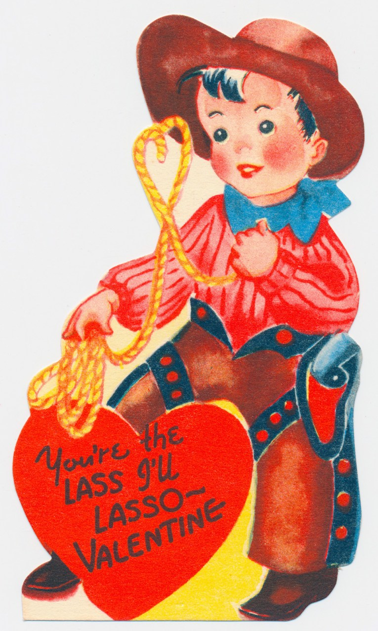 """A cowboy dressed in a red shirt and brown chaps, holding a rope. Inside a heart text reads """"You're the lass I'll lasso - Valentine"""""""