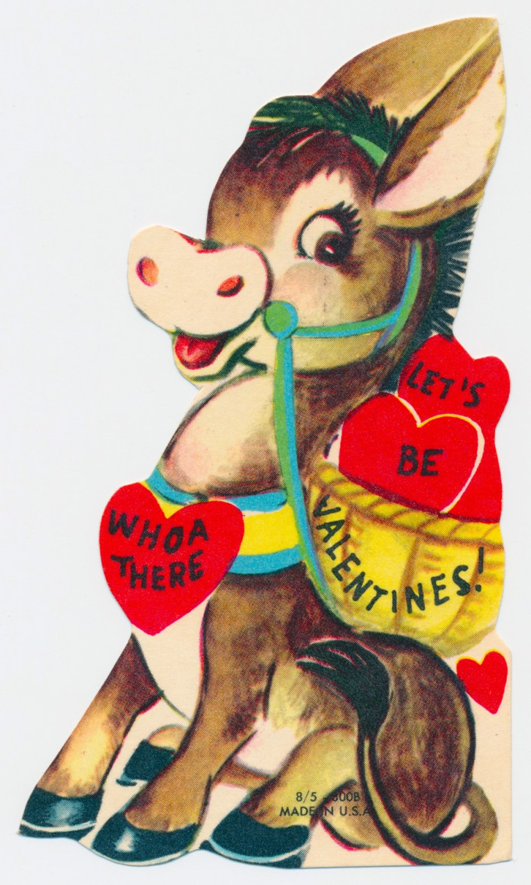 "A donkey carries a basket full of hearts, text reads ""Whoa there let's be valentines"""
