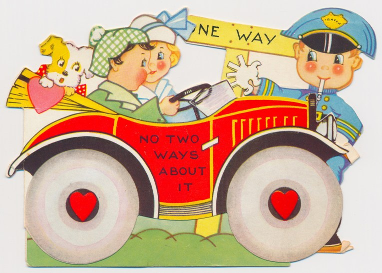 """A couple and a dog drive in a red car, a cop stands near the front gesturing to a """"One Way"""" sign. Text on the door of the car reads """"No two ways about it"""""""