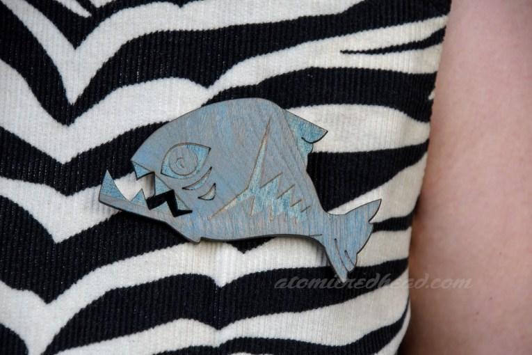 Close up of my brooch, a wooden piranha.