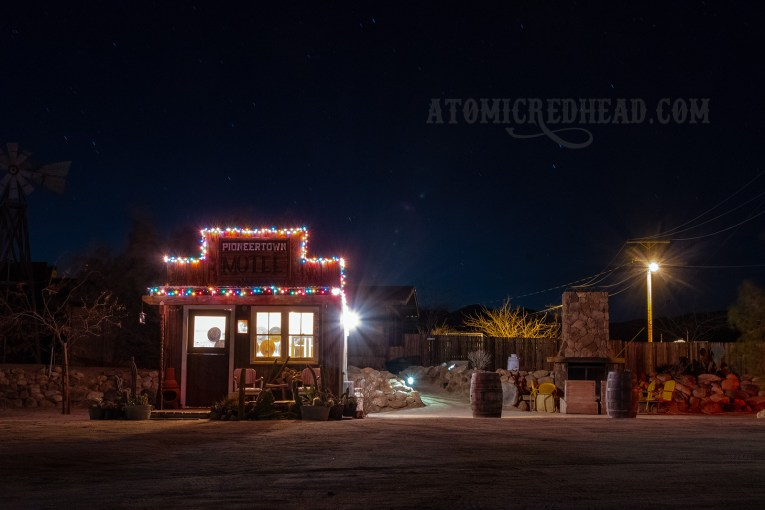 The Pioonertown Motel office shines bright under a starry sky.