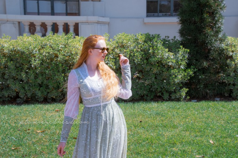 Me, standing outside Pasadena City Hall, wearing a long pale green dress with small white flowers.