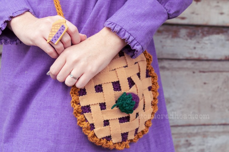 Close-up of the boysenberry pie purse, which is hand crocheted, featuring felt lattice work and a crocheted boysenberry on top.