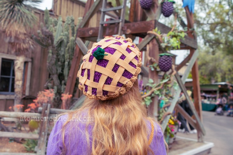 Close-up of my boysenberry pie hat, which is hand crocheted and features felt lattice work and a crocheted boysenberry on top in the middle.
