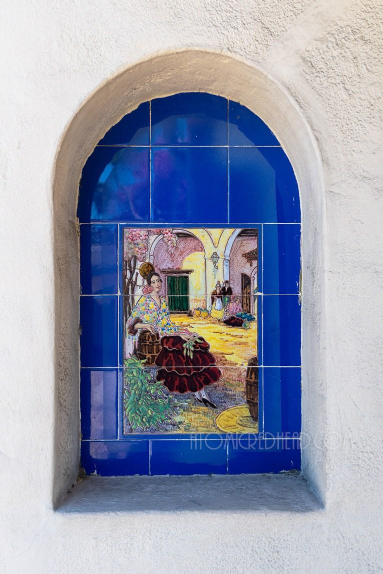 A decorative tile of a Spanish dancer.