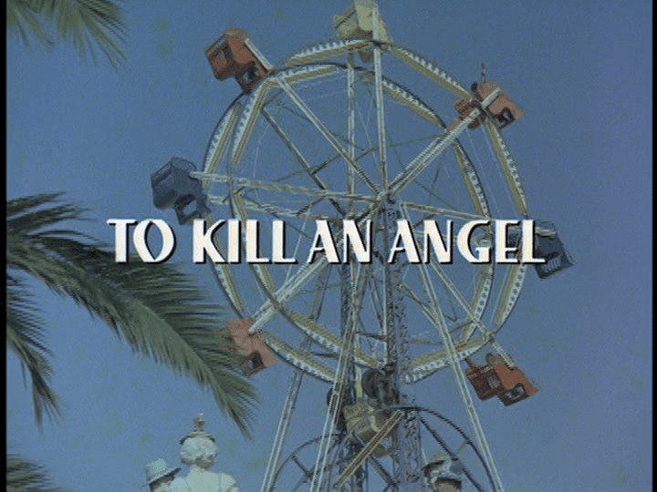 "Screencap: A ferris wheel spins with white text over the top reading ""To Kill An Angel"""