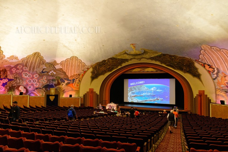 Overall shot of the theatre, with its dome roof, and mural all around.