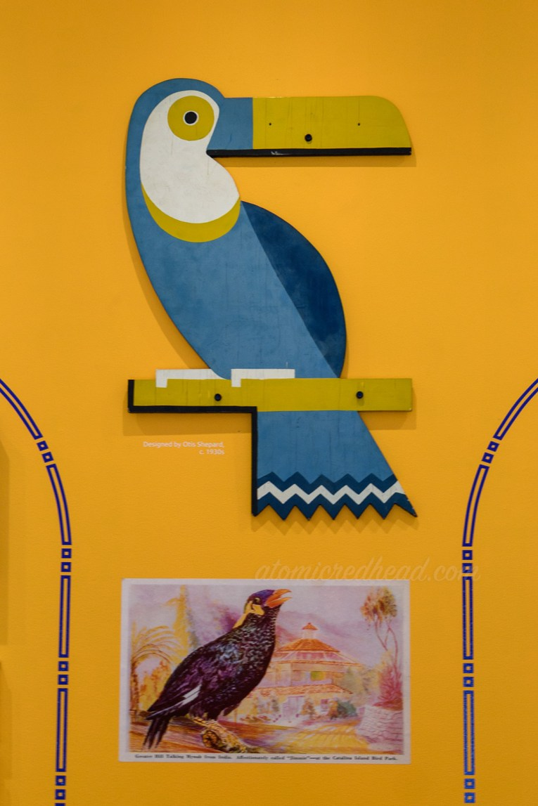Wooden cut out sign of a toucan.