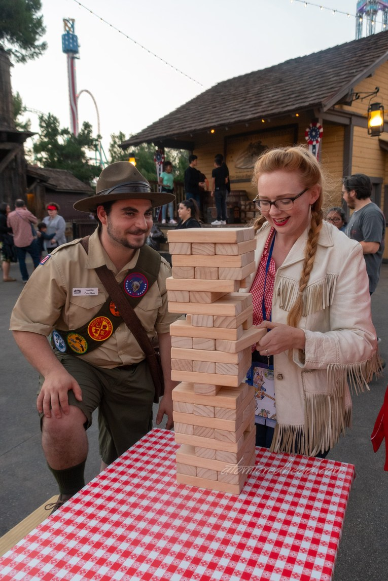 The local Boy Scout, Justin Credible, of the party planning committee, helps me with a game a giant games of Jenga.