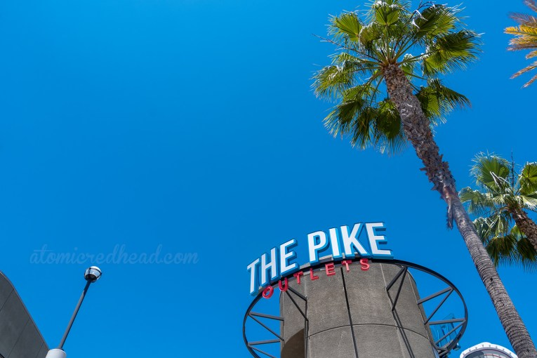 "A circular tower with letters reading ""The Pike Outlets"""