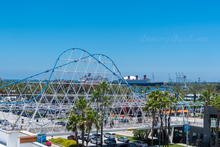 A view of the Cyclone Racer Bridge with the Queen Mary behind it.