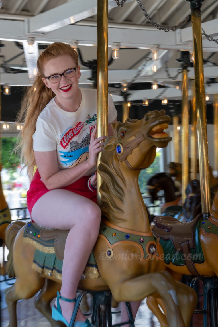 Myself riding one of the carousel horses.
