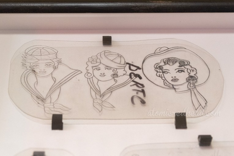 Acetate transfers for tattoos, featuring two female sailors and a cowgirl.