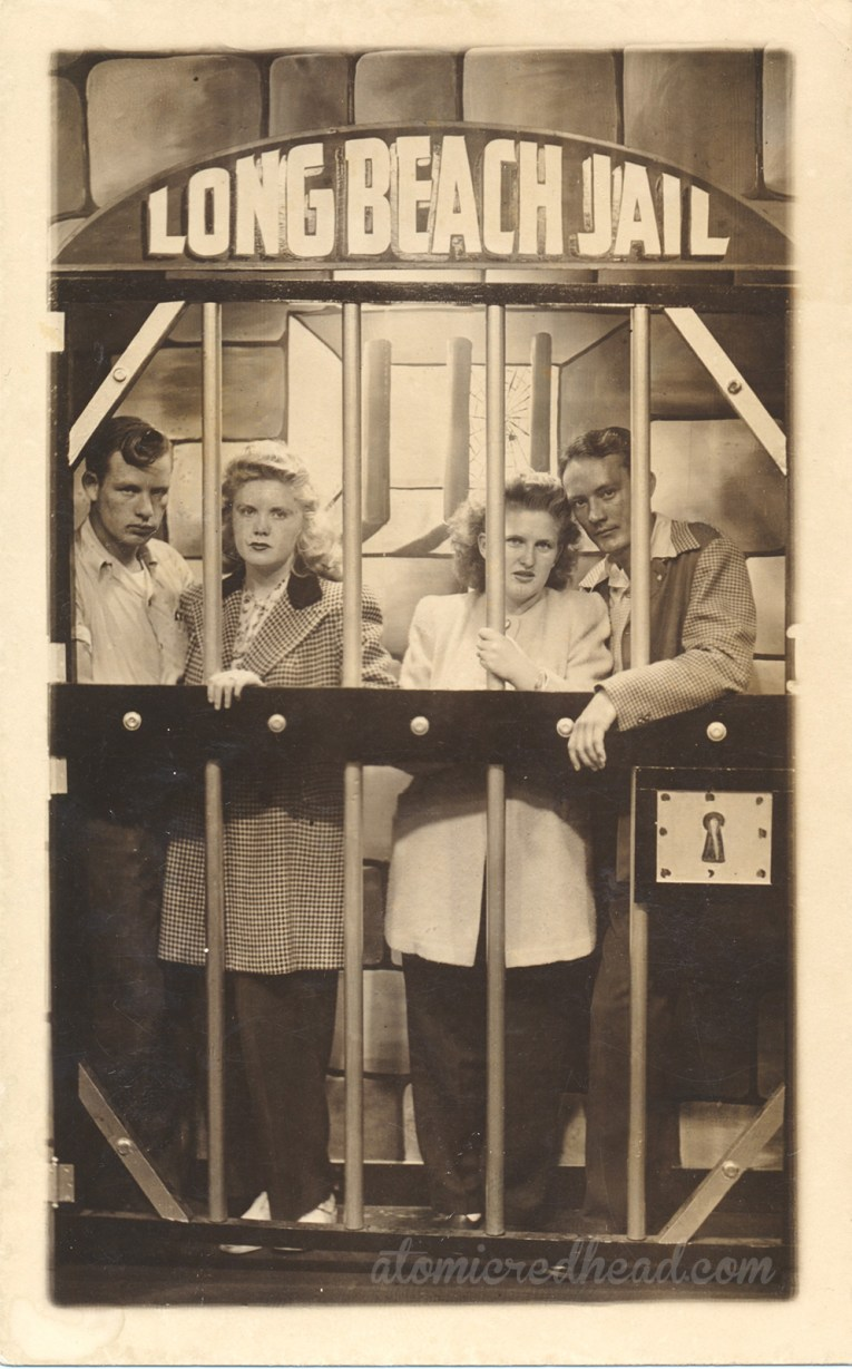 "Black and white photograph of my dad's parents and friends inside a faux jail, with text reading ""Long Beach Jail"" above."