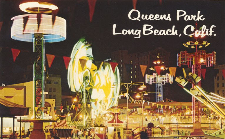 "Postcard of the Pike at night, with rides whirling around. White text reads ""Queen's Park Long Beach, California."""