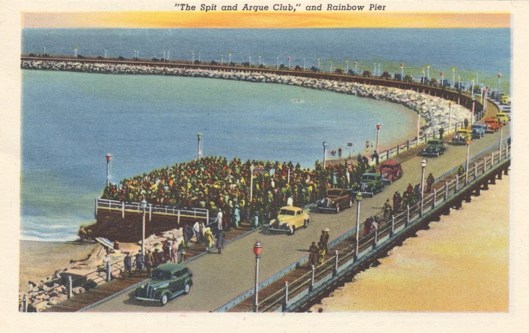 Postcard of the Rainbow Pier with cars driving along it.