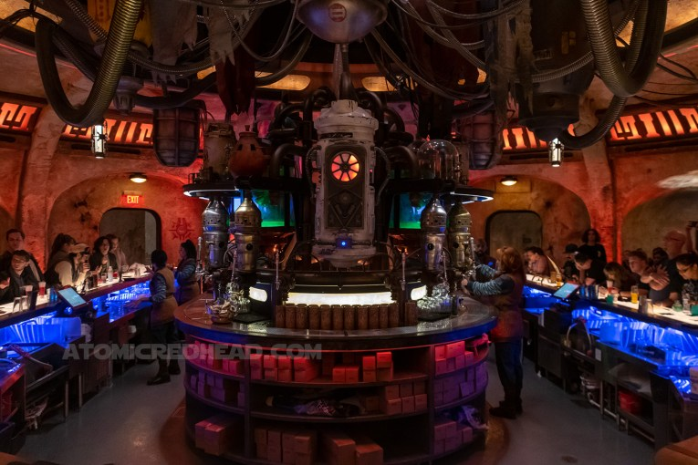 Inside of the Cantina, which features unique dispensers of various metals, some of which appear to be droid heads.